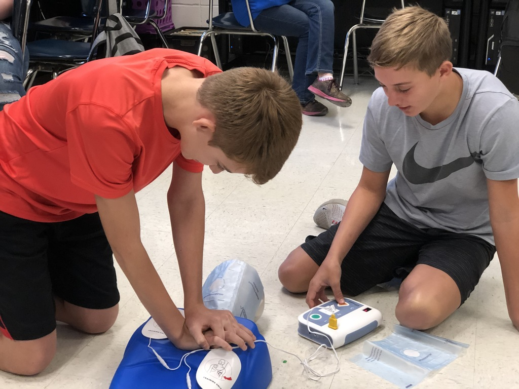 Students doing CPR.