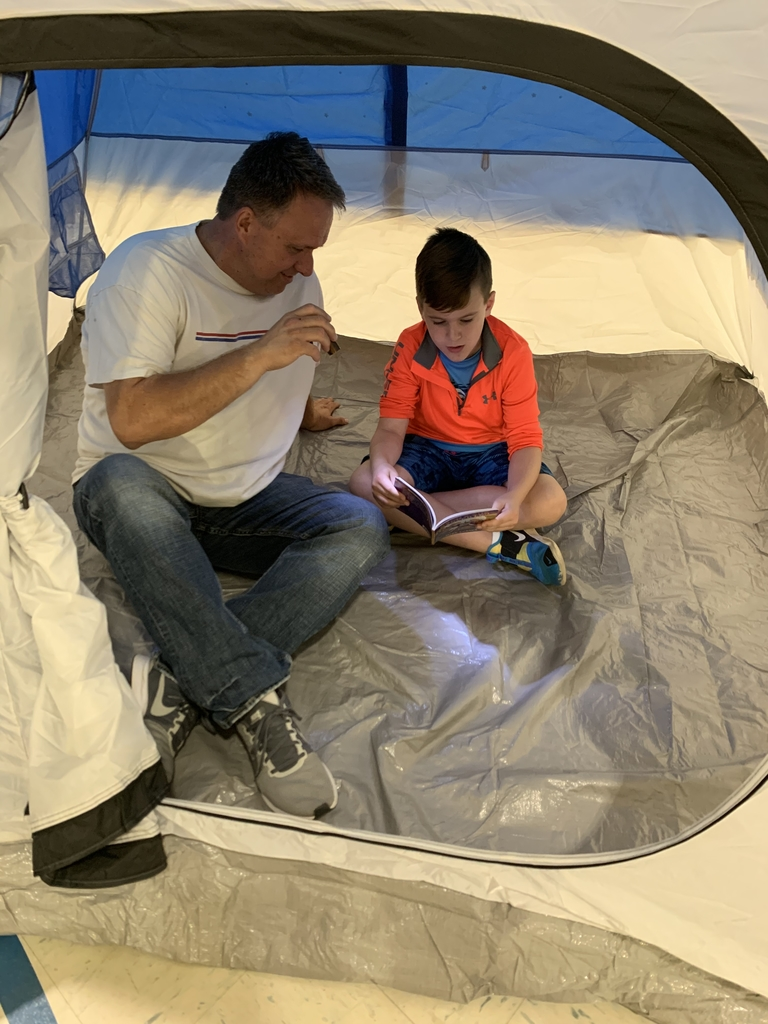 Flashlight Reading in a Tent