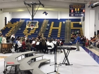 Sr. Band performs classical songs.