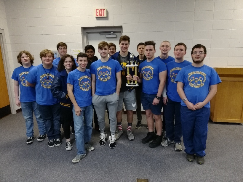 Members of the Quiz Bowl Team show off their 1st place trophy that they received after making a clean sweep by defeating Salem, Mountain Home, and Highland to take the championship.