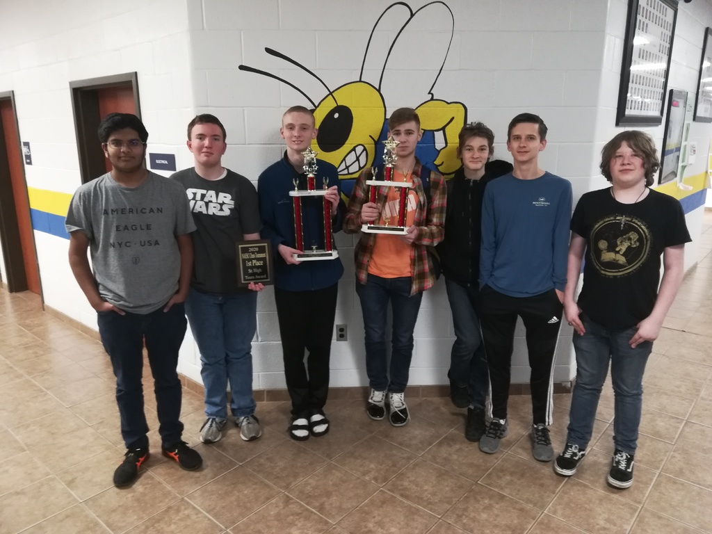 Members of the chess team hold up the trophies they won at the Coop chess tournament.