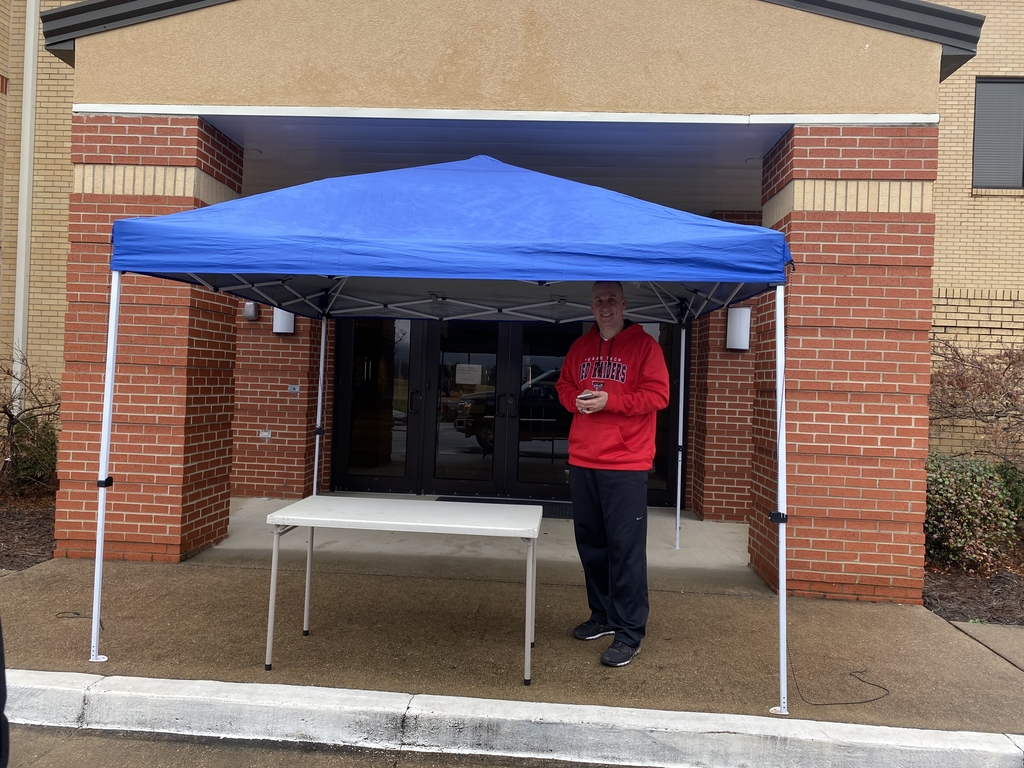 Coach Sullivan mans the food station at Flatwoods in Mt. View!